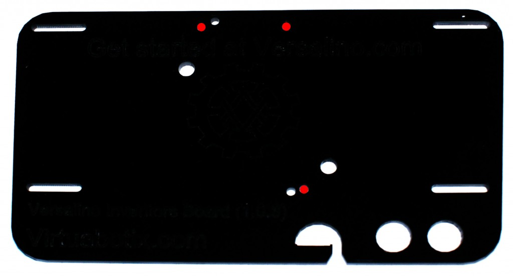This is a top view photo of the Versalino Inventors board V 1.0.3 with the holes for the Versalino Uno marked in red.